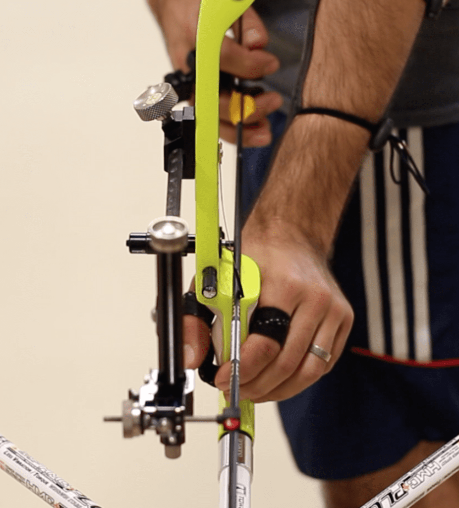 recurve archer showing grip and hook position at set from front