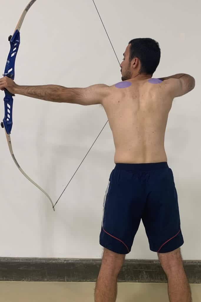 recurve archery with bad upper body posture and high shoulder position