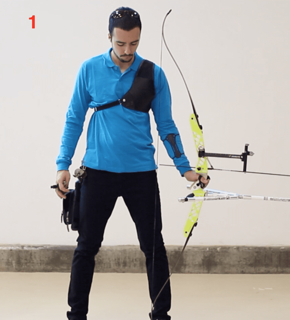 archer showing recurve set position with bow on foot