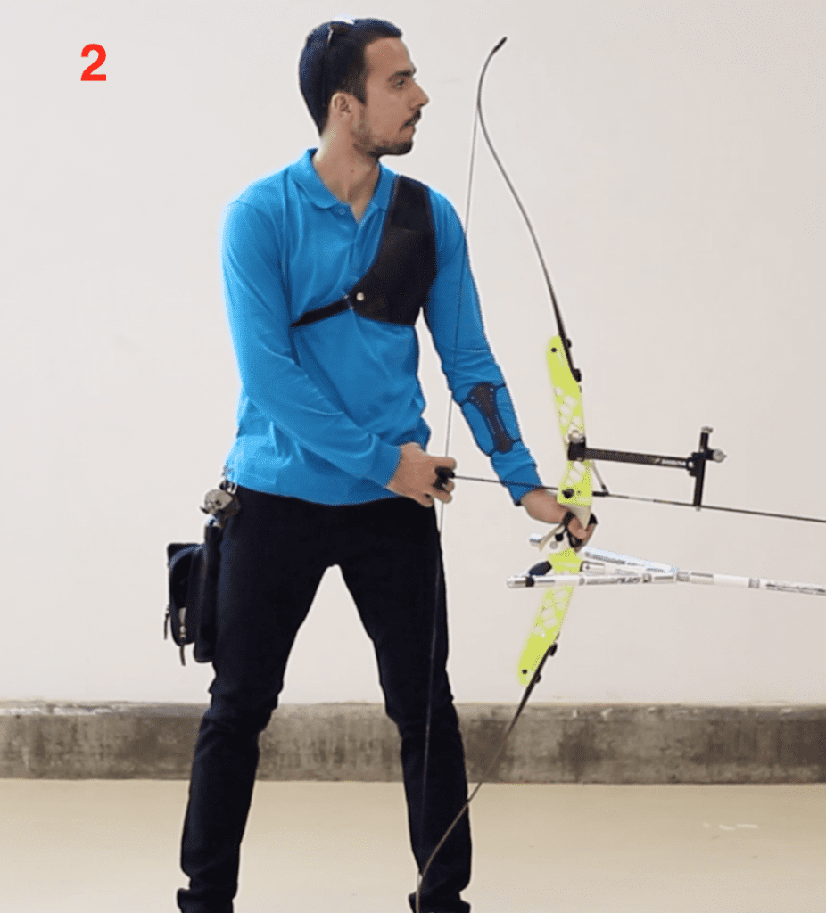 archer showing recurve archery hook position