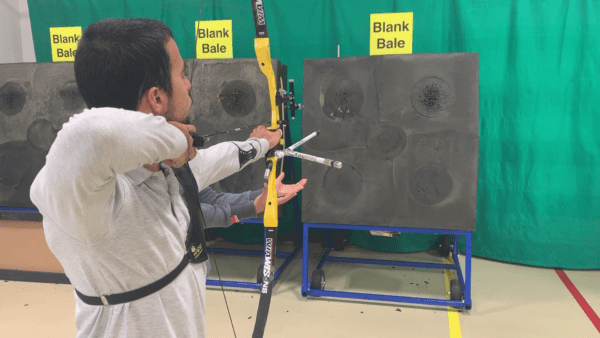 Archer showing how to learn the recurve bow hand follow-through 1