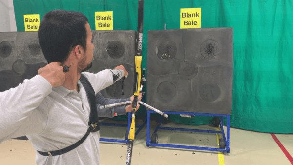 Archer showing how to learn the recurve bow hand follow-through 2