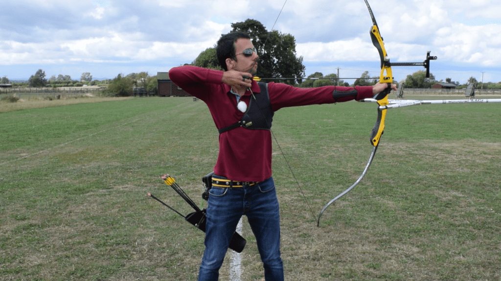 Recurve olympic archer showing release & follow through 1