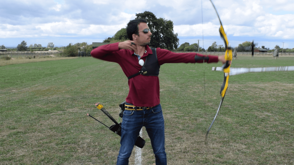 Recurve olympic archer showing release & follow through 2
