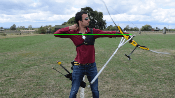 Recurve olympic archer showing release & follow through 4