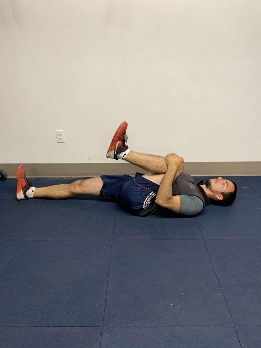 archer doing lying leg stretch
