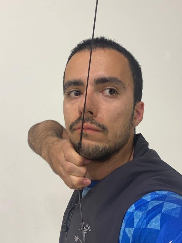 recurve archer showing good full draw position for olympic archery