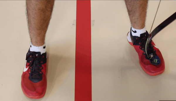 recurve technique showing open stance foot placement